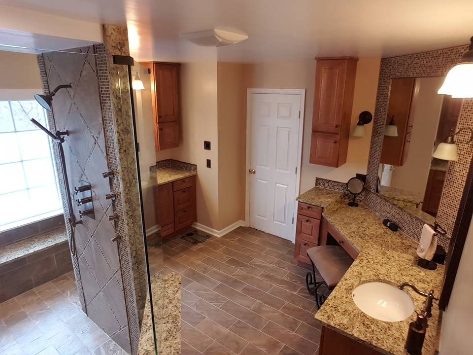 Beautiful master bathroom remodeled by Optimum Construction bathroom remodelers.
