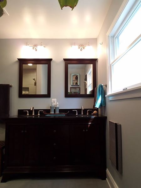 bathroom remodel with his and hers sinks